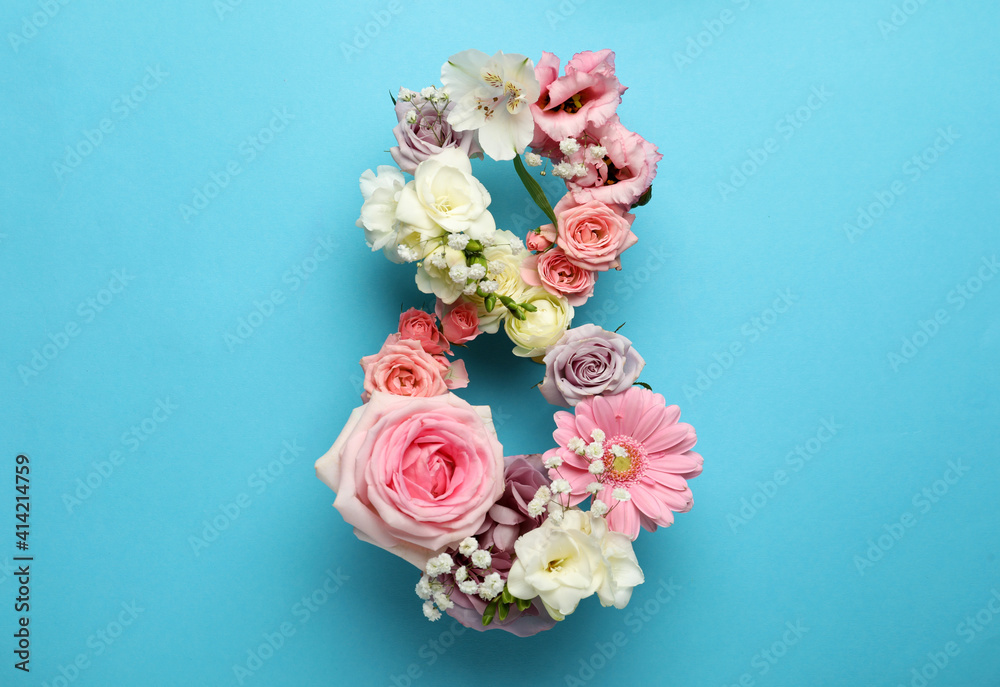 Fototapeta Number 8 made of beautiful flowers on light blue background, flat lay. International Women's day