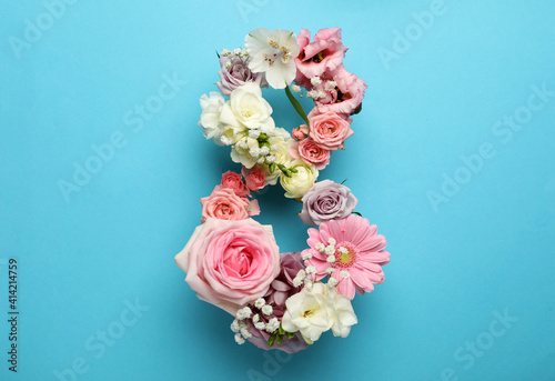 Fototapeta Number 8 made of beautiful flowers on light blue background, flat lay. International Women's day obraz