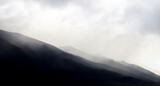 Graphic Dramatic Background Monochrome Mountain Ridges Under Clouds - 414237196