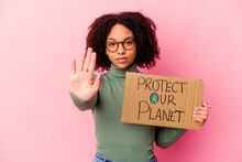 Young African American Mixed Race Woman Holding An Protect Our Planet Cardboard Standing With Outstretched Hand Showing Stop Sign, Preventing You.