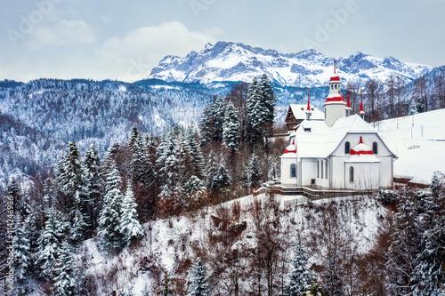 Hergiswald church in swiss Alps, Lucerne, Switzerland © Boris Stroujko