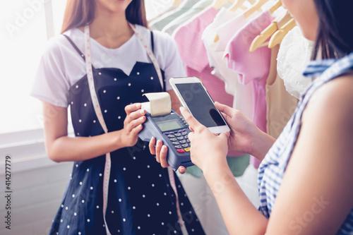 Fototapeta Money transfer payment terminal digital cash transaction using mobile smart phon