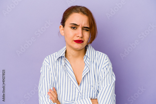 Fényképezés Young arab mixed race woman unhappy looking in camera with sarcastic expression