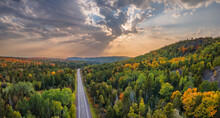 Sunset Autumn Drive Through The Tunnel Of Trees In Michigan Upper Peninsula UP - Highway 41  M26 Aerial View