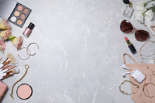 Flat Lay Composition With Makeup Products And Accessories On Light Grey Marble Background. Space For Text