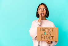 Young Hispanic Mixed Race Woman Holding A Protect Our Planet Cardboard Is Saying A Secret Hot Braking News And Looking Aside
