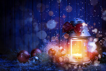 Christmas Lantern With Burning Candle And Festive Decor On Table. Magical Atmosphere