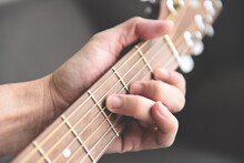 Home Hobbies Concept, Man Hands Playing Acoustic Guitar, Close Up Guitar Player Musical Instrument For Recreation Or Hobby Passion