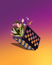 Chess Board And Tulips On A Yellow-pink Gradient Background. Creative Concept Of Marketing Strategies
