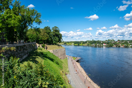 Fotografie, Obraz Old bastions and park along the Narva Promenade by the Narva River in eastern Es