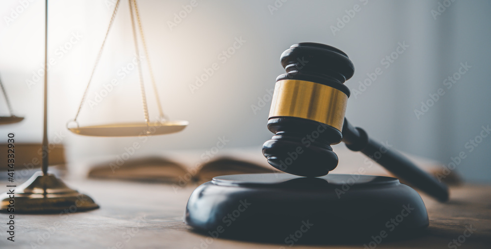 Fototapeta Law theme, mallet of the judge, law enforcement officers, evidence-based cases and documents taken into account..