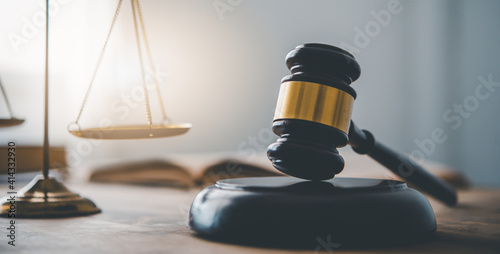 Fototapeta Law theme, mallet of the judge, law enforcement officers, evidence-based cases and documents taken into account.. obraz