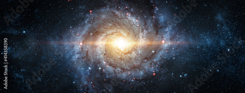 A view from space to a spiral galaxy and stars. Universe filled with stars, nebula and galaxy,. Elements of this image furnished by NASA. - fototapety na wymiar
