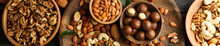 Wooden Bowls With Different Nuts On Wood Background, Top View