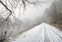 Mist Over The Teviot River And A Snow Covered Country Lane In The Scottish Borders, UK