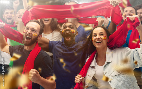 Photo Spainian football, soccer fans cheering their team with a red scarfs at stadium