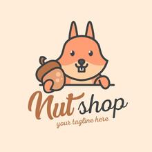 A Cute Squirrel Holds A Nut. Nut Shop Logo Or Mascot. Cute Wild Animal.