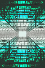 Vertical Shot Of A Reflective Modern Green Glass Building Design