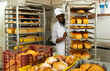 African-american lay out over trolley fresh pastries. High quality photo