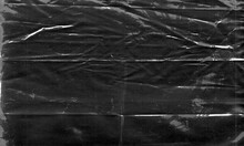 Background Texture Of A Polyethylene,plastic Transparent Black Plastic Film,transparent Stretched Background