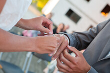Bride And Groom Exchanging Wedding Rings. Stylish Couple Official Ceremony. High Quality Photo