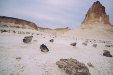 Sandy Desert Covered With Stones And Rocks