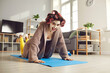 Leinwanddruck Bild - Happy young woman doing knee push-ups during fitness workout at home. Funny housewife in hair curlers and beauty face mask exercising on sports mat and looking at camera. Keeping fit concept