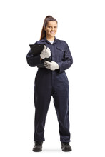 Full Length Portrait Of A Female Mechanic In A Uniform Standing And Looking At Camera