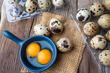 Quail Eggs On The Wooden Background