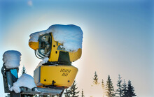 Snow Making Machine At A Ski Resort On A Sunny Winters Day.