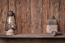 Decorative Scene With Adventure Concept With A Canteen, A Lantern And A Flashlight Made Of Sculpted Wood On A Rustic Wooden Background. 3D Rendering.