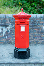 Red Post Box In City Centre Of Birmingham, United Kingdom. British Style Red Post Box. Traditional Red Post Box In UK.