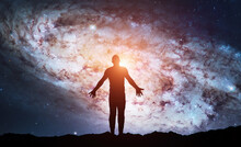 Silhouette Of Man Stand On Top Of Mountain And See In The Night Sky. Galaxy And Space. Meditation And Astrology. Esoterica And Psychology. Elements Of This Image Furnished By NASA
