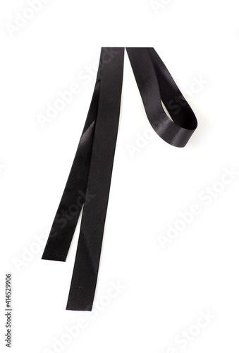 Canvas-taulu Decorative black silk ribbon isolated on white background