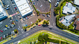 Aerial view on a busy plaza with car parking and residential houses nearby. Auckland, New Zealand.