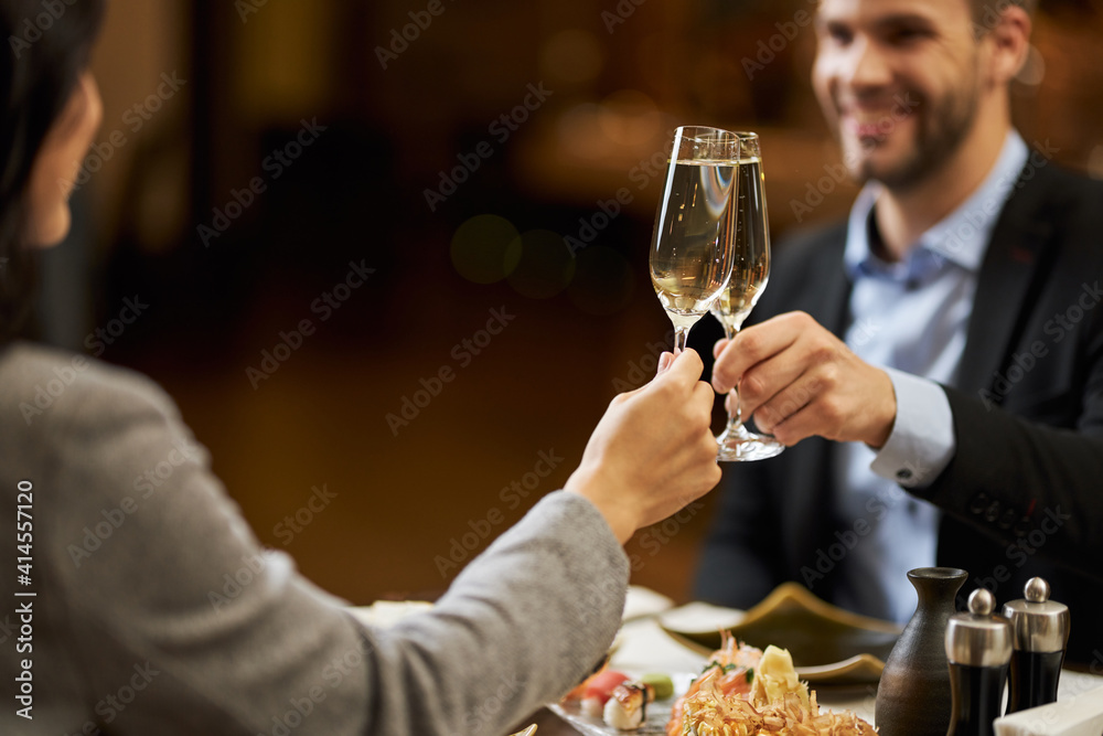 Fototapeta Cheerful man drinking champagne with his wife