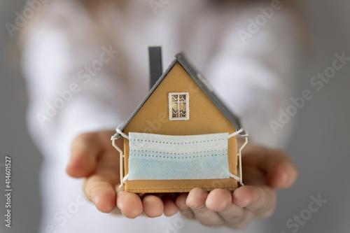 Fototapeta House with medical mask in children`s hands obraz