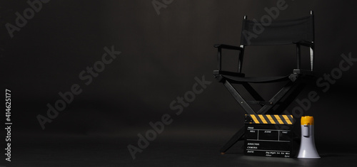 Tableau sur Toile Director chair and Clapper board or movie Clapperboard with yellow megaphone on black background