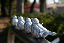 Four Metal Bird Sculptures