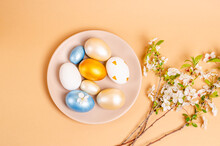 Easter Nacreous Eggs On A Plate On A Beige Background With Copy Space.