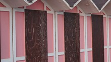 A Set Of Pink Beach Huts With A Wooden Door In A Bathhouse (Pesaro, Italy, Europe)