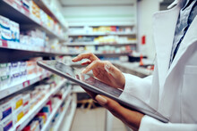 Closeup Of Hands Of Young Female Pharmacist Checking Inventory In Medical Store Using Digital Tablet