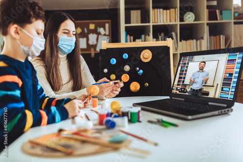 Fotografie, Obraz Children with protective mask presenting there science home project - the planets of our solar system