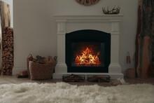 Firewood Burning Bright In Elegant Hearth Indoors