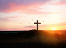 Christian Cross On Hill Outdoors At Sunset. Crucifixion Of Jesus