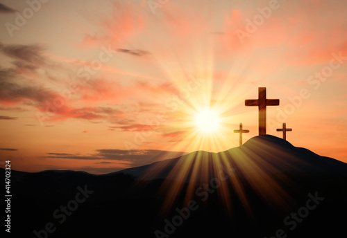 Foto Christian crosses on hill outdoors at sunset