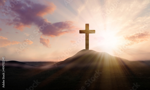 Slika na platnu Christian cross on hill outdoors at sunrise