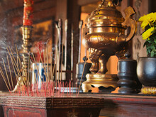 Burning Incense Sticks In A Buddhist Temple