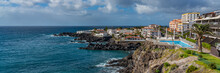 Tropical Island Of Tenerife. Panorama Of The Coastline With Buildings With A Pool