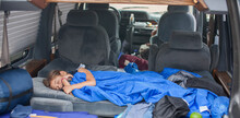 Young Girl Sleeping In A Car